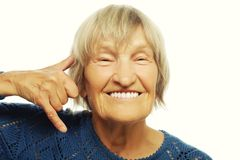 Senior woman is making a call me gesture Stock Photo