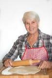 Senior woman making cookies Royalty Free Stock Photos