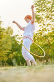 Senior woman making fitness exercises in the park Stock Photography