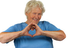 Senior woman is making a heart Royalty Free Stock Photos