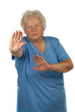 Senior woman is making stop gesture Royalty Free Stock Photos