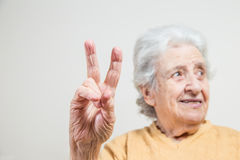 Senior woman making victory (V) sign Royalty Free Stock Image