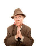 Senior woman in male clothing with hands together Royalty Free Stock Photography