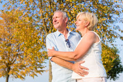 Senior woman and man, couple, embracing each other Stock Images