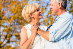 Senior woman and man, couple, embracing each other Royalty Free Stock Images