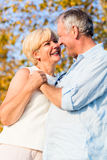 Senior woman and man, couple, embracing each other Stock Photos