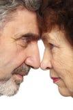 Senior woman, man face to face Stock Photography