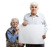 Senior woman and man holding a blank billboard Royalty Free Stock Images