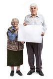 Senior woman and man holding a blank billboard Stock Images