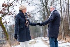 Senior woman and man saying goodbye Stock Photography