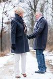 Senior woman and man saying goodbye Stock Images