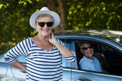Senior woman with man sitting in car Royalty Free Stock Images
