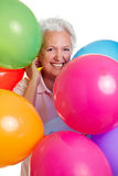 Senior woman with many balloons Stock Photography