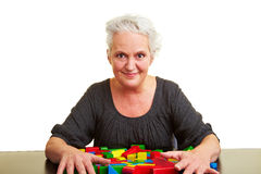 Senior woman with many building Stock Images