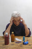 Senior woman with many drugs Royalty Free Stock Images