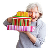 Senior woman with many gifts Stock Image