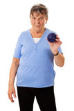 Senior woman with massage ball Stock Images