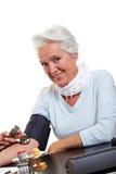 Senior woman measuring blood Stock Photography