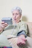 Senior woman measuring blood pleasure Stock Photo