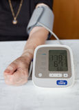 Senior woman measuring her blood pressure Royalty Free Stock Photography