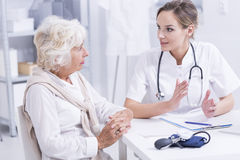Senior woman during medical consultations Stock Photo
