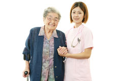 Senior woman with medical staff Royalty Free Stock Photography