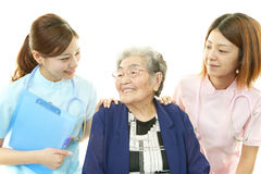 Senior woman with medical staff Royalty Free Stock Photo