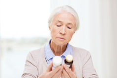 Senior woman with medicine jars at home Royalty Free Stock Images