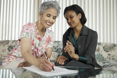 Senior woman meeting with agent Royalty Free Stock Photo