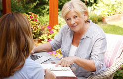 Senior woman meeting with agent Royalty Free Stock Image