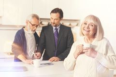 Senior woman meeting their insurance agent at home Royalty Free Stock Image