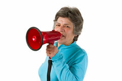 Senior woman with megaphone Stock Image