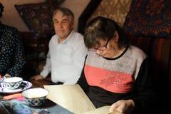 Senior woman with menu Royalty Free Stock Image