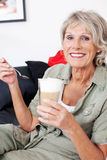 Senior woman with milky macchiato coffee Stock Photos