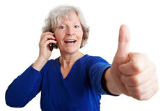Senior woman with mobile phone Stock Images