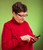 Senior woman with mobile phone Stock Photos