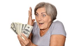Senior woman with money Stock Photo