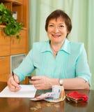 Senior woman with money Royalty Free Stock Photo