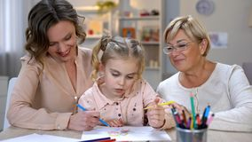 Senior woman, mother and girl drawing picture, spending fun time together, art. Stock photo royalty free stock image