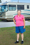 Senior Woman with Motor Home. Senior woman standing in front of her luxury motor home Royalty Free Stock Photography