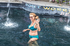 Senior woman in the nature Thermae swimming pool. Tropical island Bali, Indonesia. Stock Photo