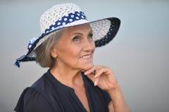 Senior woman near lake Royalty Free Stock Image