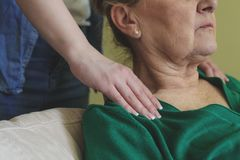 Senior woman neck massage royalty free stock image