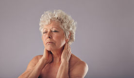 Senior woman with neck pain Stock Images