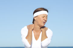 Senior woman neck pain sky background Royalty Free Stock Image