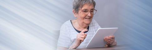 Senior woman and new technologies. panoramic banner stock image