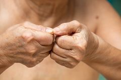 Senior woman nibbling nails, Body language feeling stock images