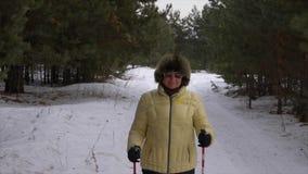 Senior woman nordic walking stock footage