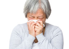 Senior woman with nose allergy. Isolated on white background Stock Photo