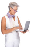 Senior woman with notebook Royalty Free Stock Images